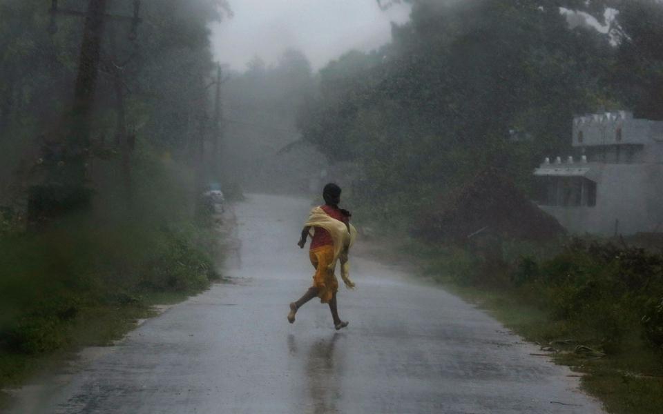 Mass Evacuations As Super Cyclone Phailin Hits India