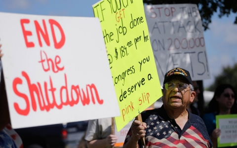 Veteran Raul Sanchez protests for federal workers idled by the government shutdown in San Antonio, Texas.