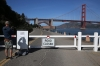 <b>San Francisco, Calif.</b> A visitor photographsa sign announcing the closure of Fort Point National Historic Site.