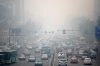 Vehicles in Harbin are engulfed by smog Sunday. The air quality was so bad that the city closed schools on Monday.