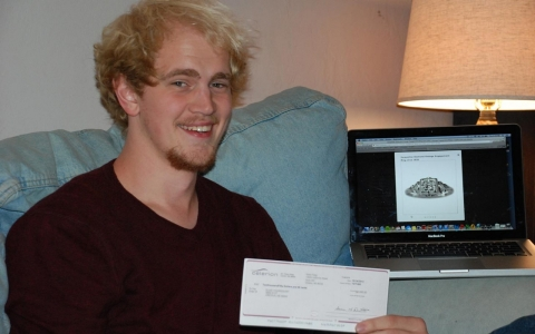 Elias Youngquist, 21, holds up the check he earned after giving himself up for medical research to pay for an engagement ring.