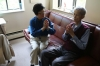 Reverend Chang meets with Kam Hi Tse, 78, who suffers from cancer, in his Manhattan apartment.