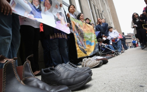 Shoes symbolizing deported fathers are displayed during a demonstration in New York City in June.