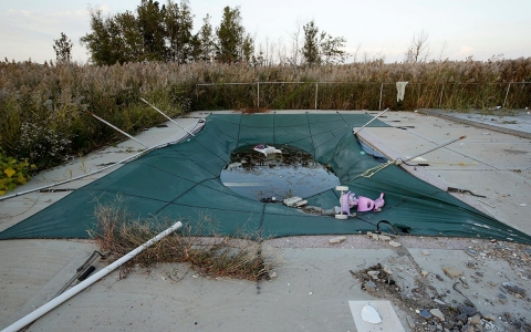 An abandoned swimming pool remains in the lot of a house in the low-lying Oakwood Beach neighborhood on Staten Island's Southeastern shore.