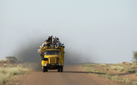 African migrants travel in the back of a truck across the Sahara Desert on Sept. 26, 2004 near Agadez, Niger.