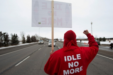 An Idle No More supporter blocks Highway 2 as part of a planned national day of action, in Edmonton, Alberta, last January.