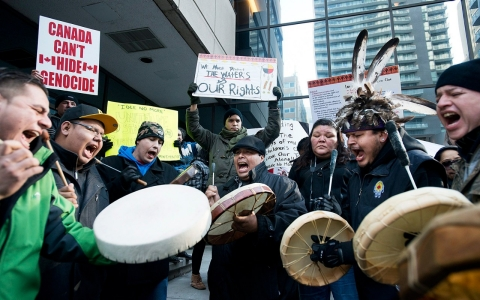 Idle No More protesters demonstrate outside the British Consulate at College Park in Toronto last January.
