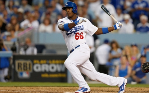 L.A. Dodgers rookie sensation Yasiel Puig was one of 21 Cuban-born players on major league rosters in 2013.