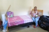 Diane Wick sits on her daughter Jill's bed, which has been empty for weeks.