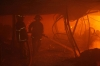 Firefighters try to control a fire inside a garment factory in the Bangladeshi town of Gazipur,  north of the capital Dhaka on Wednesday.