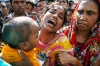 An unidentified relative of a Bangladeshi garment factory worker cries at the scene of the fire.