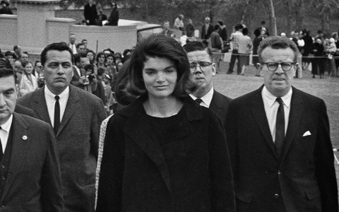 Hill, at left behind Jackie Kennedy, on the way to the president's funeral.