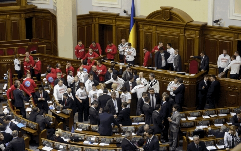 Pro-EU deputies of the Ukrainian opposition block the parliament tribune as a sign of protest after a plan to sign a historic EU deal