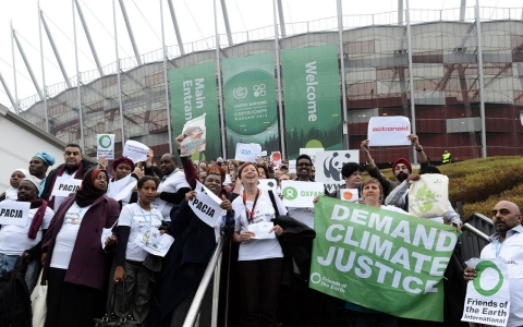 Members of NGOs walk out of United Nations Climate Change Conference COP 19 in Warsaw on November 21, 2013. They protested as they claim were