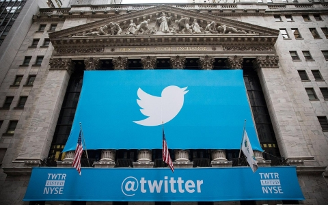 The Twitter logo is displayed on a banner outside the New York Stock Exchange on Thursday.