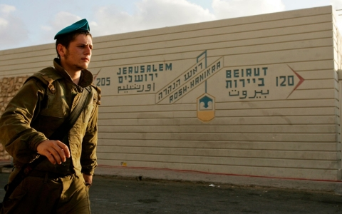 An Israeli solider walks past the Rosh Hanikra border crossing between Israel and Lebanon