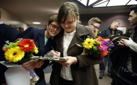 Natalie Dicou , left, and her partner, Nicole Christensen, wait to get married at the Salt Lake County clerk's office in Salt Lake City, Utah on Dec. 20, 2013.