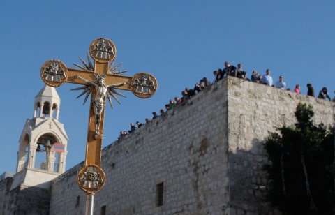 This file photo shows a cross in front of the Church of Nativity