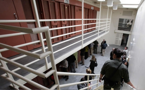 Reporters inspect one of the two-tiered cell pods in the Secure Housing Unit at the Pelican Bay State Prison near Crescent City, Calif., Wednesday, Aug. 17, 2011.