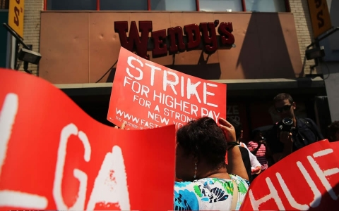 Employees and supporters demonstrate outside of a Wendy's fast-food restaurant on July 29, 2013 in New York City.