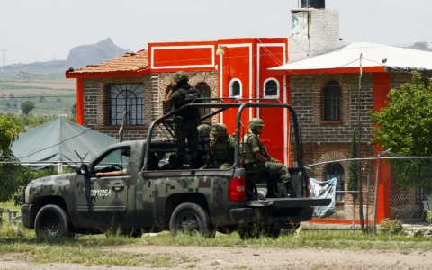 Members of the Army patrol the surroundings of the Puente Grande State prison in Zapotlanejo, Jalisco State, Mexico, Friday.
