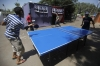 Members of the Muslim Brotherhood and supporters of deposed Egyptian President Morsi play ping pong outside tents in Giza, south of Cairo August 12, 2013.
