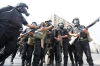 Riot police gather during a crackdown on supporters of deposed President Morsi around Cairo University, Wednesday.