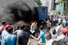 Morsi supporters surround a burning police car during clashes with Egyptian security forces in Cairo's Mohandessin neighborhood, Wednesday.