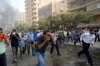 Egyptian Muslim Brotherhood supporters run for cover from tear gas fired by police in a street leading to Rabaa al-Adawiya protest camp in Cairo on August 14, 2013.