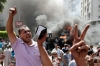 Morsi supporters chant slogans against Egyptian Defense Minister Gen. Abdel-Fattah el-Sissi during clashes with security forces in Cairo's Mohandessin neighborhood, Wednesday.