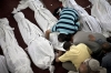 Egyptians mourn over a body at a mosque in Cairo, Thursday.