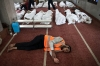 An Egyptian volunteer sleeps on the carpet of a mosque in Cairo where lines of bodies wrapped in shrouds were laid out on Thursday, following a bloody crackdown on the protest camps of supporters of ousted Islamist president Mohamed Morsi the previous day.