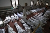 Lines of bodies killed in clashes with Egyptian security forces are wrapped in shrouds at a mosque in Cairo on Thursday.