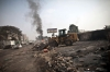A tractor clears the debris at Rabaa al-Adawiya square in Cairo on Thursday.