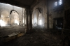 Egyptian men walk through debris and rubble inside the burnt down mosque of  Rabaa al-Adawiya, Thursday in Cairo, Egypt.