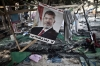 A picture of Egypt's ousted president Mohamed Morsi hangs admidst debris at Rabaa al-Adawiya square in Cairo on Thursday after the crackdown.
