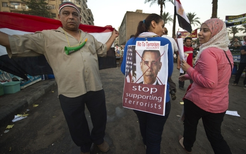 A woman turns her back to show off Obama poster in Tahrir Square on July 3, 2013.