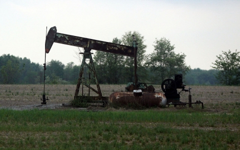 A pump jack works on Wednesday, April 4, 2012, in Cisne, Illinois, as nearby areas are marked for the start of fracking operations.