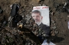 A trampled poster of Egypt's ousted President Mohammed Morsi is seen on the ground outside the Rabaah al-Adawiya mosque, where supporters of Morsi had a protest camp in Nasr City, Cairo, Egypt on Friday