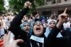 Morsi supporters take part in a protest near Ennour Mosque in Cairo on Friday.