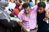 Supporters of deposed Egyptian President Mohamed Morsi help a protester affected by tear gas during clashes outside Al-Fath mosque in Ramses square, Cairo on Friday.