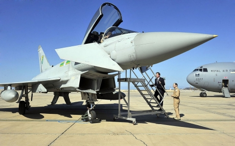 British Prime Minister David Cameron boards a RAF jet headed for Oman.