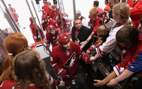 Rostislav Klesla of the Phoenix Coyotes is greeted by fans after the NHL game against the Detroit Red Wings on April 4, 2013 in Glendale, Ariz