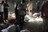 People inspect victims of the attack in Ghouta.