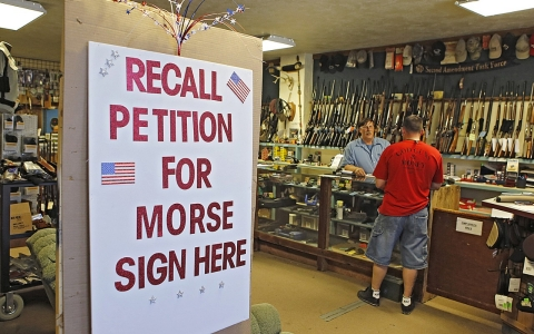 A sign at Paradise Firearms in Colorado Springs, Colo., invites customers to sign a recall petition against Colorado Democratic State Senate President John Morse.