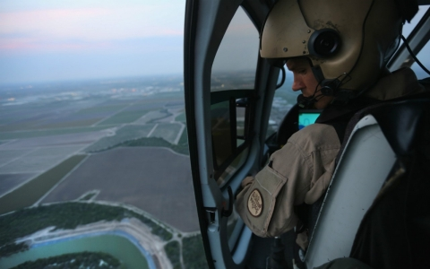 A Border Patrol agent flies over the U.S. and Mexico border above Havana, Texas.
