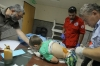 A boy receives medical treatment at a hospital after two powerful explosions hit Tripoli, Lebanon, on Friday.
