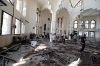 People inspect the damage inside one of two mosques hit by explosions in Lebanon's northern city of Tripoli, Aug. 23, 2013.