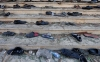 Shoes and slippers belonging to people attending Friday prayers lie near one of two mosques after an explosion that claimed more than 20 lives.