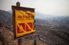 A fire-restriction sign partially burned by the Rim Fire near Buck Meadows, Calif., on Thursday.
